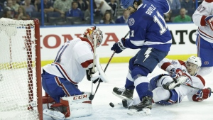 Tampa Bay Lightning center Brian Boyle (11) attempts a shot between Montreal Canadiens goalie Carey Price (31) and defenseman Alexei Emelin of Russia, right, during second period of Game 3 NHL second round playoff hockey action, Wednesday, May 6, 2015, in Tampa, Fla. (AP Photo/Wilfredo Lee)
