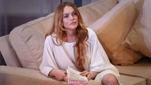 "U.S actress Lindsay Lohan performs a scene from the play, ""Speed the Plow,"" during a photocall at the Playhouse Theatre in central London on Sept. 30, 2014. (AP / Invision, Joel Ryan)"