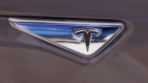 The Tesla logo on a Tesla Model S 70D in Detroit, on April 7, 2015. (AP / Carlos Osorio)