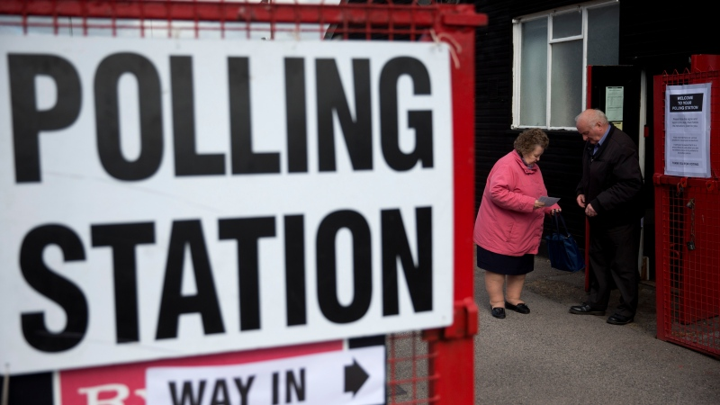 People leave a polling station at Ramsgate Football Club, in Ramsgate, south east England, Thursday, May 7, 2015. (AP / Matt Dunham)