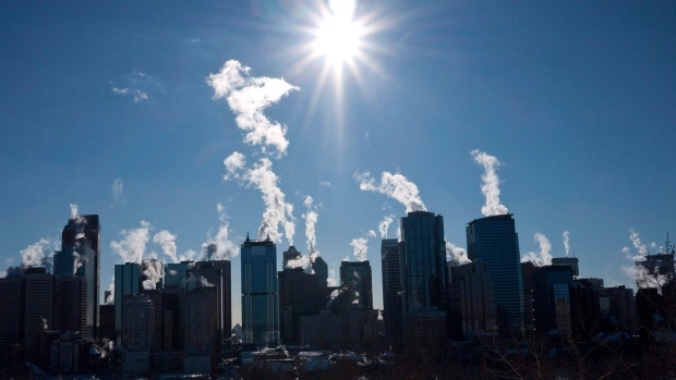 Steam rises from downtown Calgary office towers, on Monday, Jan. 31, 2011. (THE CANADIAN PRESS/Jeff McIntosh)