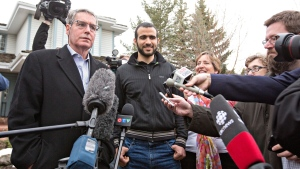 Omar Khadr's and his lawyer Dennis Edney speak to media after being released on bail in Edmonton, Alta., on Thursday May 7, 2015. (Jason Franson / THE CANADIAN PRESS)