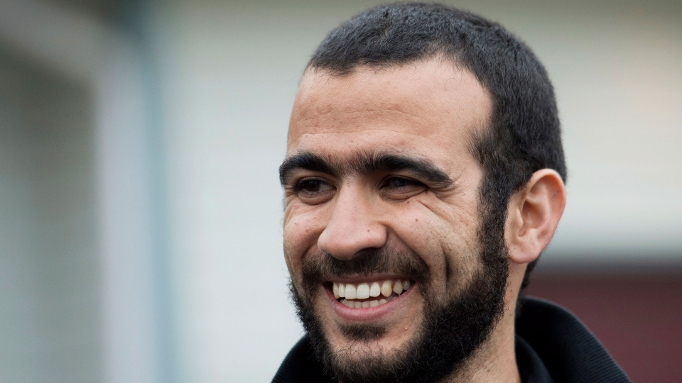 Omar Khadr smiles as he speaks to the media outside his new home, also his lawyer's home, after being granted bail in Edmonton on Thursday, May 7, 2015. (Nathan Denette / THE CANADIAN PRESS)