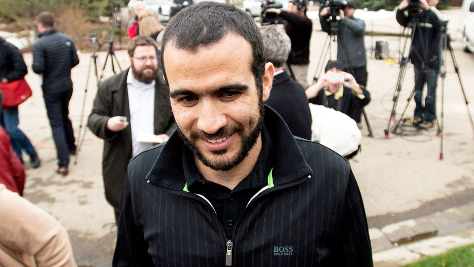Omar Khadr walks back to his home after speaking to the media after being granted bail in Edmonton on Thursday, May 7, 2015. (Nathan Denette / THE CANADIAN PRESS)