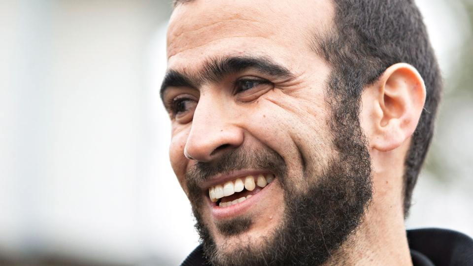 Omar Khadr speaks to media after being released on bail in Edmonton, Alta., on Thursday, May 7, 2015. (Jason Franson / THE CANADIAN PRESS)