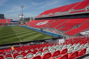 A worker fixes a seat at Toronto FC's BMO Field on Thursday, May 7, 2015, as work continues to ready the newly revamped stadium ahead of the Sunday home opener. (THE CANADIAN PRESS/Chris Young)