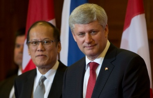 Canadian Prime Minister Stephen Harper and Philippines President Benigno S. Aquino III take part in a joint news conference on Parliament Hill Friday, May 8, 2015 in Ottawa. (THE CANADIAN PRESS / Adrian Wyld)