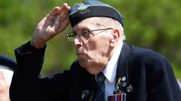 Second World War veteran John Newell, 92, of Ottawa, salutes during a ceremony to mark the 70th anniversary of VE-Day at the National War Memorial in Ottawa on Friday, May 8, 2015. (Sean Kilpatrick / THE CANADIAN PRESS)