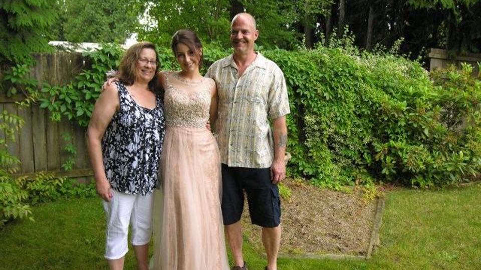 Emily Janzen poses for a photo with her mother Laurel and father Randy in this June 2014 Facebook image.
