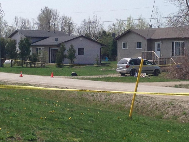 Police tape blocks off the area a day after a man was found dead on Saugeen First Nation, Friday, May 8, 2015. (Scott Miller / CTV London)