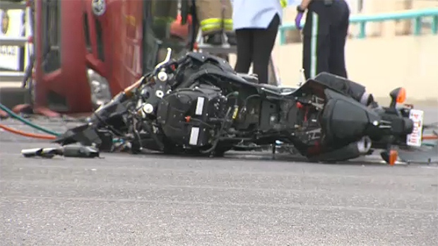 Police say a car was turning left when the motorcycle crashed into it.