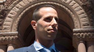 Sandro Lisi walks out of Old City Hall Court in Toronto after being found not guilty on drug related charges on Friday, May 8, 2015. (Frank Gunn / THE CANADIAN PRESS)
