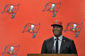 Tampa Bay Buccaneers first-round draft pick Jameis Winston smiles during a news conference Friday, May 1, 2015, in Tampa, Fla. Winston, a former Florida State quarterback, was the first overall pick. (AP/Chris O'Meara)