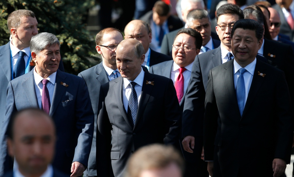 From left: Kyrgyz President Almazbek Atambayev, Russian President Vladimir Putin, Chinese President Xi Jinping walk before the Victory Parade marking the 70th anniversary of the defeat of the Nazis in World War II, in Red Square, Moscow, Russia, Saturday, May 9, 2015. (AP / Alexander Zemlianichenko Jr.)