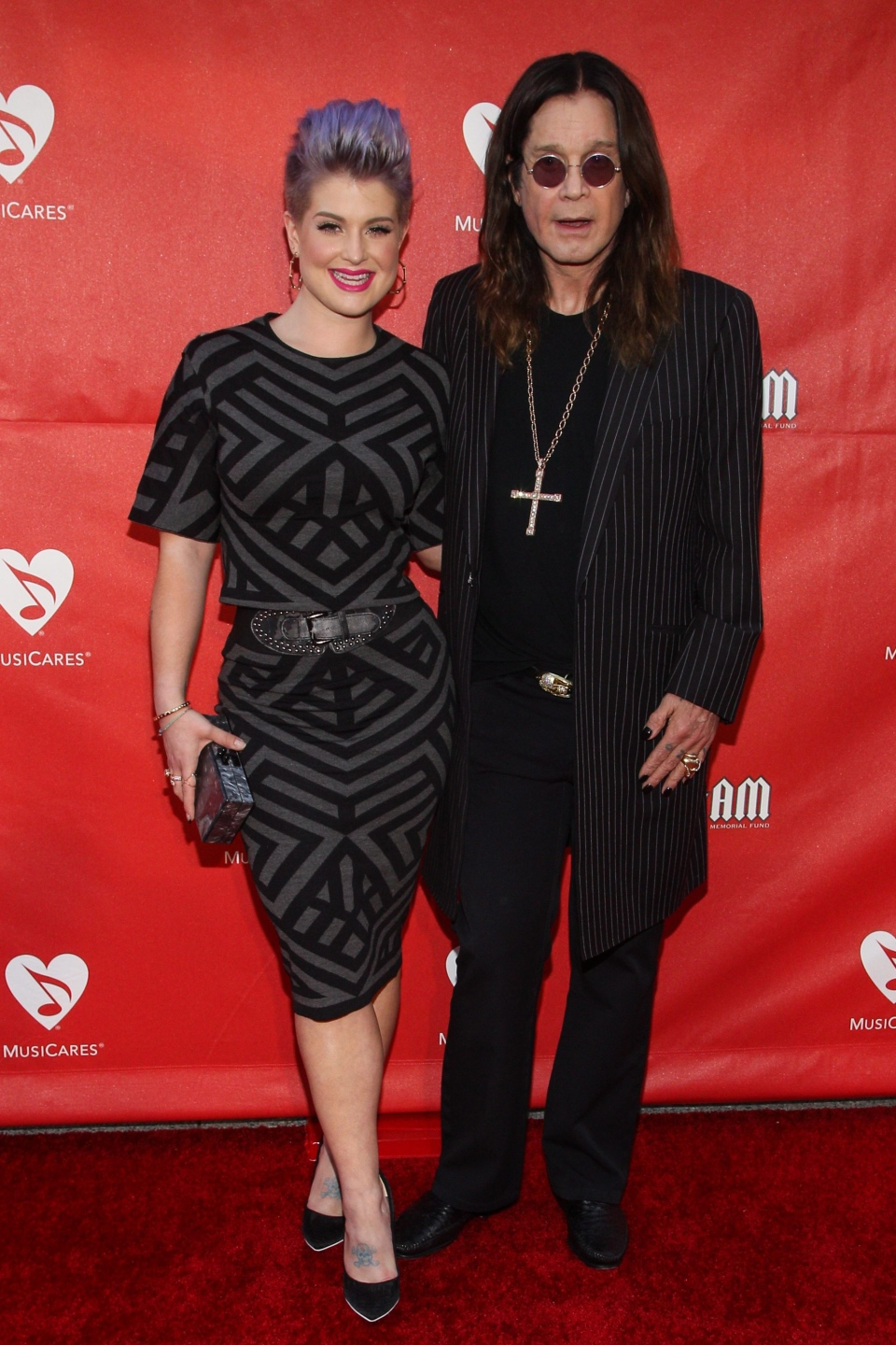 Kelly Osborne, left, and Ozzy Osbourne attend the 10th annual MusiCares MAP Fund Benefit Concert at Club Nokia on May 12, 2014 in Los Angeles. (Paul A. Hebert / Invision / AP)