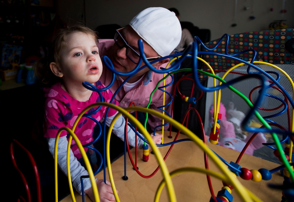 Alex Repetski, right, plays with his two-year-old daughter Gwenevere in Toronto on Tuesday, April 7, 2015. Gwenevere's epileptic seizures are being treated with cannabidiol, one of several active cannabinoids found in the marijuana plant. (Nathan Denette /The Canadian Press)