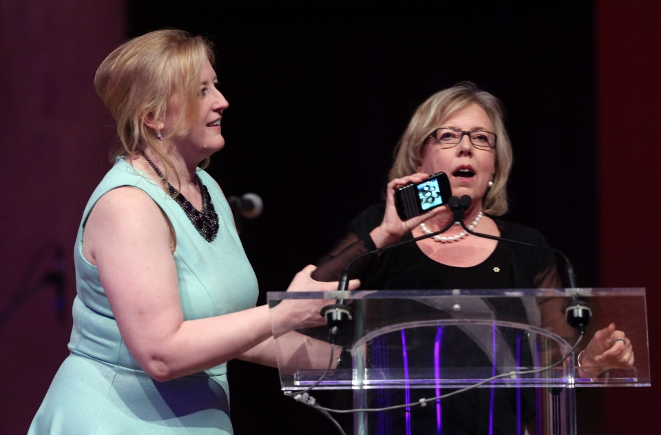 Transport Minister Lisa Raitt (left) prompts Green Party Leader Elizabeth May to stop her speech and leave the stage, Saturday, May 9, 2015. (Fred Chartrand / THE CANADIAN PRESS)
