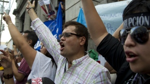 Protesters demand the resignation of Guatemalan President Otto Perez Molina near Congress in Guatemala City on May 9, 2015. (AP / Moises Castillo)