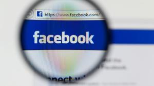 Facebook under a microscope. (Gil C / Shutterstock.com)