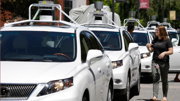 A row of Google self-driving Lexus cars