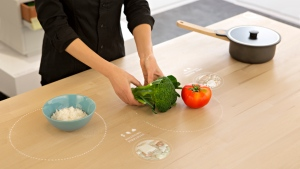 Ikea's kitchen of the future features a smart table that can detect ingredients and suggest recipes.