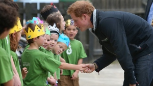 Prince Harry smiles as he shakes hands with a student while visiting Halfmoon Bay school on Stewart Island, New Zealand, Monday, May 11, 2015. (AP / Robyn Edie)