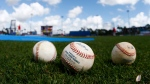 In this March 12, 2015, file photo, baseballs sit shown on the field before an exhibition spring training baseball game between in Port St. Lucie, Fla. (AP / John Bazemore)