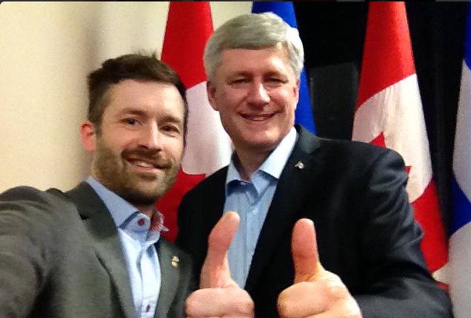 Chris Lloyd and Prime Minister Stephen Harper are seen in this undated photo posted on the @dearpm Twitter account in March.