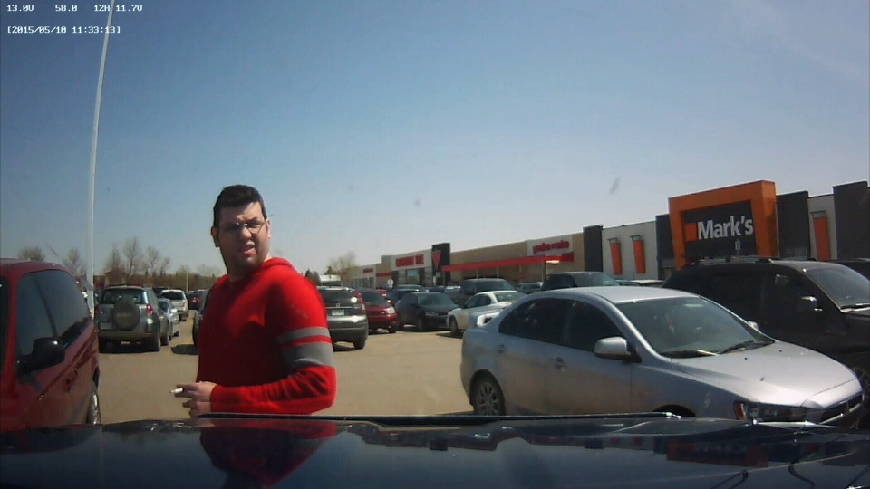 An alleged vehicle vandal is seen in this image captured from video taken by a dashboard camera.