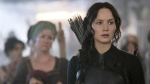 In this image released by Lionsgate, Jennifer Lawrence portrays Katniss Everdeen in a scene from 'The Hunger Games: Mockingjay Part 1.' (AP / Lionsgate, Murray Close)