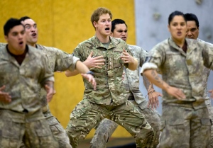 Prince Harry performs a haka, a traditional Maori challenge, with 1 Brigade soldiers during a visit to the Linton Military Camp near Palmerston North, New Zealand, Wednesday, May 13, 2015. (Mark Mitchell/New Zealand Herald via AP)