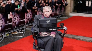 Professor Stephen Hawking poses for photographers upon arrival for the Interstellar Live show at the Royal Albert Hall in central London, Monday, March 30, 2015. (Joel Ryan / Invision)