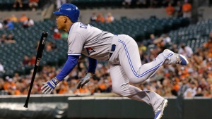 Toronto Blue Jays' Ezequiel Carrera leaps as he is hit by a pitch during the fifth inning of a baseball game against the Baltimore Orioles in Baltimore, Tuesday, May 12, 2015. (AP / Patrick Semansky)