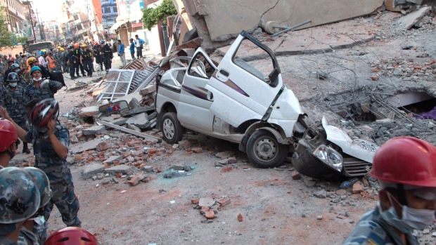 A car is seen smashed under the weight of a building that collapsed in an earthquake in Kathmandu, Nepal, Tuesday, May 12, 2015. (AP / Ranup Shrestha)
