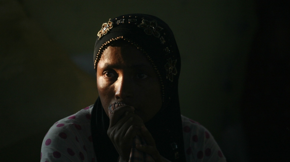 An ethnic Rohingya woman ponders at a temporary shelter for the migrants whose boats washed ashore on Sumatra island on Sunday, in Lapang, Aceh province, Indonesia, Wednesday, May 13, 2015. (AP/Binsar Bakkara)