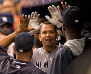 New York Yankees' Alex Rodriguez, center, celebrates with teammates in the dugout after hitting a solo home run off Tampa Bay Rays starter Alex Colome during the first nning of a baseball game Monday, May 11, 2015, in St. Petersburg, Fla. (AP / Steve Nesius)