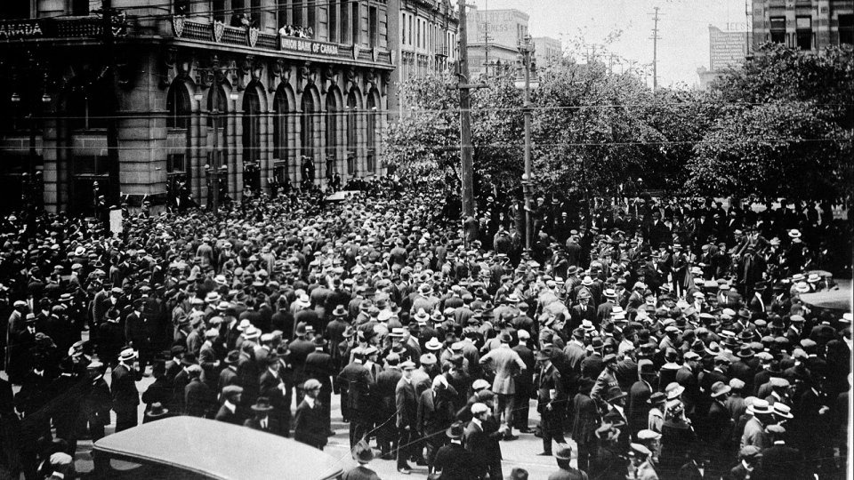 Crowds gathered outside the Union Bank of Canada building on Main Street during the Winnipeg General Strike, June 21,1919.(CP PHOTO/ National Archives of Canada)