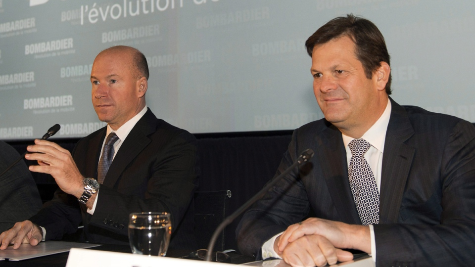 Bombardier Inc. chief executive Alain Bellemare, left, and Chairman Pierre Beaudoin get set to start the company's annual meeting, in Montreal, Thursday, May 7, 2015. (Ryan Remiorz / THE CANADIAN PRESS)