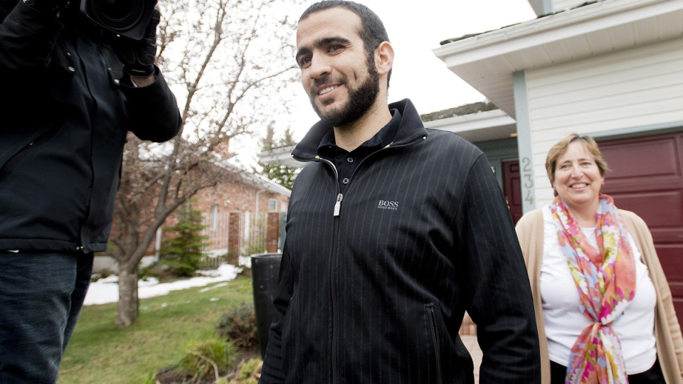 Omar Khadr walks out to speak with reporters