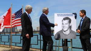 Michigan Governor Rick Snyder (left to right), Prime Minister Stephen Harper and Murray Howe, Gordie Howe's son, announce that the Detroit River International Crossing will be named the Gordie Howe International Bridge, on the waterfront, in Windsor, Ont., Thursday, May 14, 2015. (Dave Chidley / THE CANADIAN PRESS)