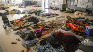 Shelter seekers sleep in their assigned spaces at the Astumbo Elementary School in Dededo, Guam during the early morning hours of May 15, 2015. (AP / The Pacific Daily, Rick Cruz)