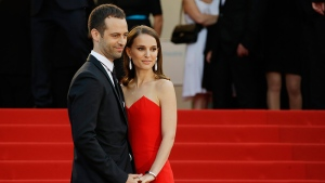 Natalie Portman, right, with husband Benjamin Millepied arrive for the opening ceremony and the screening of the film La Tete Haute (Standing Tall) at the 68th international film festival, Cannes, southern France, Wednesday, May 13, 2015. (Joel Ryan /Invision/AP)