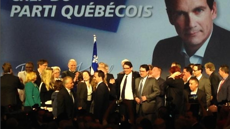 A jubilant Pierre Karl Peladeau is seen with PQ MNA Bernard Drainville after the leadership vote that put Peladeau into the top job Friday in Quebec City. (CTV Montreal Max Harrold)