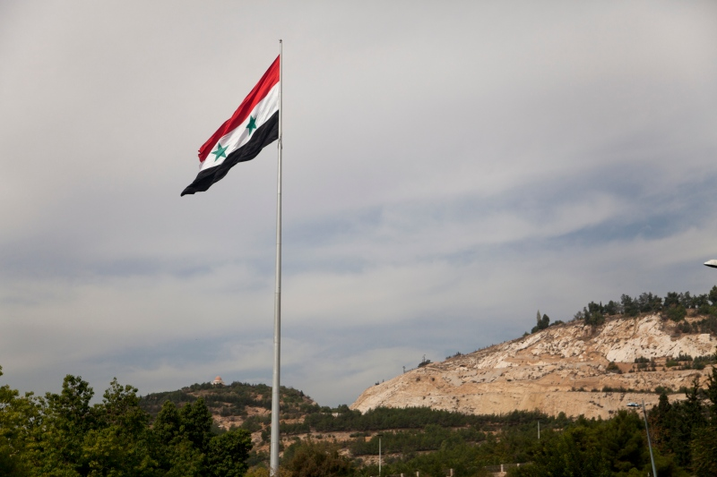 A Syrian flag flies over the capital of Damascus on Monday, Oct. 27, 2014. (AP / Diaa Hadid)