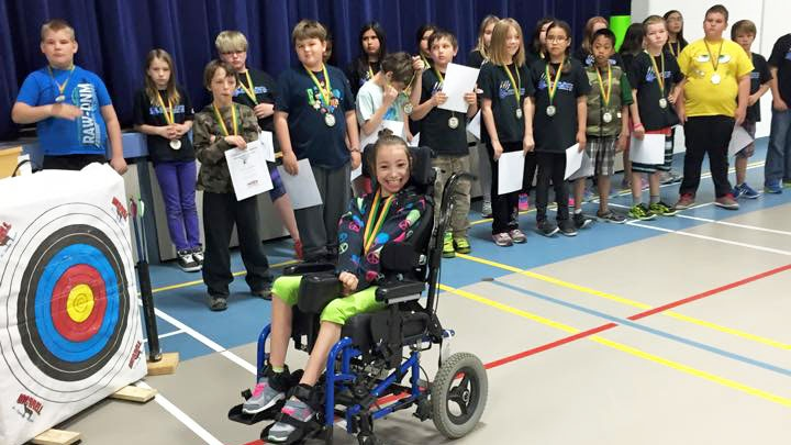 Cadence Flaata receives an award for archery (Facebook/Northern Lights Adaptations)