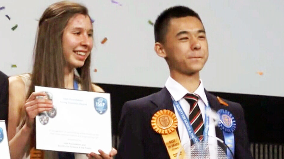 Nicole Ticea, 16, and Raymond Wang, 17, celebrate their victories at the world's largest high school science fair on Saturday, May 16, 2015.