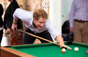 Britain's Prince Harry plays pool while visiting the Turn Your Life Around youth center in Auckland, New Zealand on Friday, May 15, 2015. (Lawrence Smith / Pool Photo via AP)