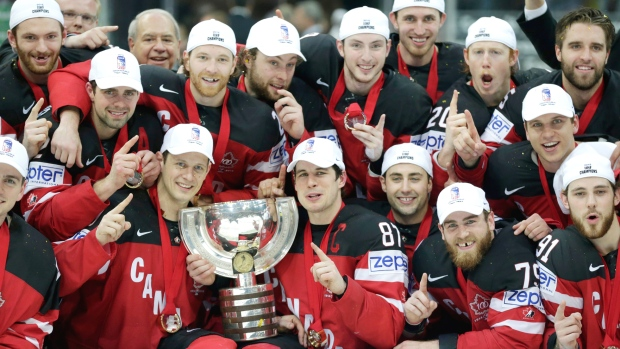 Team of Canada celebrates after winning the title at the Hockey World Championships in Prague, Czech Republic, Sunday, May 17, 2015. (AP / Petr David Josek)