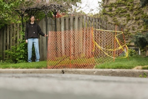 Richard Massie stands next to the hole in the ground where a Canada Post community mailbox was supposed to go in Hamilton, Ont. on Friday, May 15, 2015. (Peter Power / THE CANADIAN PRESS)