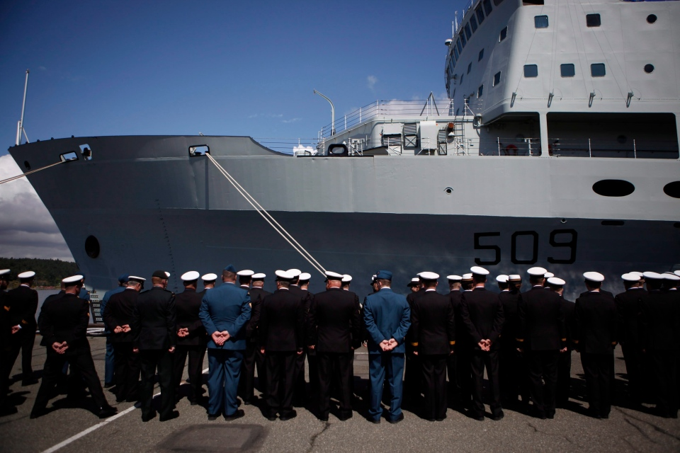 The last serving crew members of HMCS Protecteur line up during a paying-off ceremony in Esquimalt, B.C., Thursday May 14, 2015. (Chad Hipolito / THE CANADIAN PRESS)